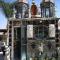 Unusual Chapel made of Beer Bottles, Martin Sanchez